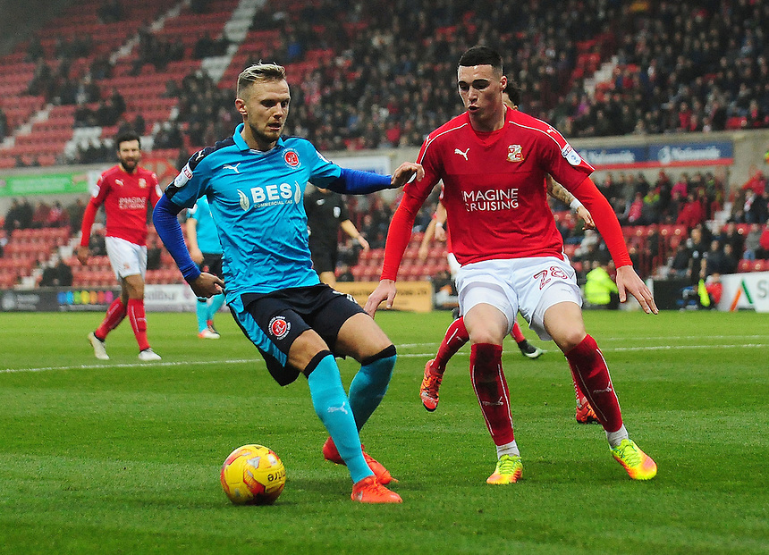 Fleetwood Town's David Ball under pressure from Swindon Town's Lloyd Jones<br /> <br /> Photographer Kevin Barnes/CameraSport<br /> <br /> The EFL Sky Bet League One - Swindon Town v Fleetwood Town - Saturday 17th December 2016 - County Ground - Swindon<br /> <br /> World Copyright &copy; 2016 CameraSport. All rights reserved. 43 Linden Ave. Countesthorpe. Leicester. England. LE8 5PG - Tel: +44 (0) 116 277 4147 - admin@camerasport.com - www.camerasport.com