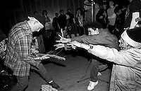 Operation Ivy fans jokingly taunt guitarist Tim Armstrong during a performance at the Veterans Hall in Davis, California, 1987. photo copyright - Trent Nelson. http://www.trenthead.com