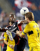 After New England Revolution forward Dimitry Imbongo (92) fails to control the ball, Columbus Crew defender Chad Marshall (14) heads it away. In a Major League Soccer (MLS) match, the New England Revolution defeated Columbus Crew, 2-0, at Gillette Stadium on September 5, 2012.