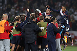 12 JUN 2010:  The USA team and bench celebrate the game tying goal by Clint Dempsey (USA)(hidden in the pack).  The England National Team played the United States National Team played to a 1-1 tie at Royal Bafokeng Stadium in Rustenburg, South Africa in a 2010 FIFA World Cup Group C match.