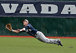 March 30, 2012:   BYU Cougars outfielder Stephen Wells dives for a ball against the Nevada Wolf Pack during their NCAA baseball game played at Peccole Park on Friday afternoon in Reno, Nevada.