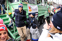 February 4, 2015 - Boston, Massachusetts, U.S. - New England Patriots quarterback Tom Brady (12) gets of a duck boat with son Benjamin at the end of a parade held in Boston to celebrate the team's victory over the Seattle Seahawks in Super Bowl XLIX. Eric Canha/CSM
