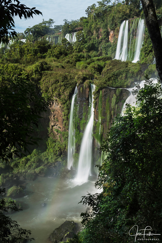 Iguazu Falls National Park in Argentina.  A UNESCO World Heritage Site.  Pictured are the Adam and Eve Falls with a faint rainbow.