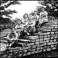 BNPS.co.uk (01202 558833)<br /> Pic:   HistoryPress/BNPS<br /> <br /> Brenda and Nancy Harrison on top of stack of wood at sawmill (Nancy at top, Brenda next to her).<br /> <br /> These inspiring photos tell the little known story of the patriotic women who chopped down trees to help us win the Second World War.<br /> <br /> When war was declared in September 1939 Britain was almost completely dependent on imported timber and only had seven months worth of it stockpiled.<br /> <br /> With men being sent to the front line in their droves, the Woman's Timber Corps was established to fell trees, operate sawmills and run forestry sites.<br /> <br /> About 15,000 women, some as young as 14, volunteered to carry out the arduous tasks previously done by men.
