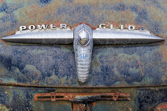 Old Chevy car trunk lid from the fifties with the new Power Glide emblem, a new automatic transmission design.