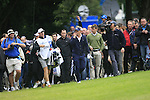 Luke Donald emerges from the trees after sending his ball way to the right after teeing off on the 1st hole during the Final Day of the BMW PGA Championship Championship at, Wentworth Club, Surrey, England, 29th May 2011. (Photo Eoin Clarke/Golffile 2011)