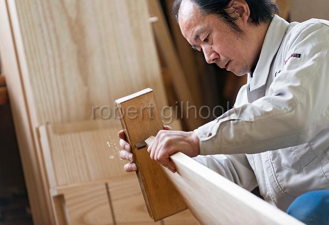 Tsutomu Ohashi, 51, works on kiri-tansu furniture at Kamo Kiri-tansu maker Asakura Kagu in Niigata City, Niigata Prefecture Japan on Feb. 21, 2017. ROB GILHOOLY PHOTO