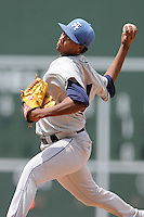 Starting pitcher Johendi Jiminian (31) of the Asheville Tourists delivers a pitch in a game against the Greenville Drive on Sunday, July 20, 2014, at Fluor Field at the West End in Greenville, South Carolina. Asheville won game one of a doubleheader, 3-1. (Tom Priddy/Four Seam Images)