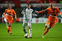 Thursday 28 November  2013  Pictured: Alejandro Pozuelo makes a run past Andres Guardado and Jeremy Mathieu of Valencia<br /> Re:UEFA Europa League, Swansea City FC vs Valencia CF  at the Liberty Staduim Swansea