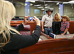 Nevada Assemblywoman Michele Fiore poses as her attache takes a photo of her with Ammon Bundy and his son Hayden, 10, at the Legislative Building in Carson City, Nev., on Monday, March 30, 2015. <br /> Photo by Cathleen Allison