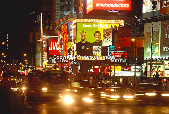 COAMENY35052.Country. America. New York. The newly  remodeled Time Square. Theqatres, neon lights, billboards, traffic. Night time. Vibrant energy. .©Per-Anders Pettersson / iAfrika Photos
