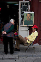 Chinese vendors sell portraits of the late chairman Mao Zedong in Beijing, China on September 30, 2009. (Canon 5D, 50mm f1.2)
