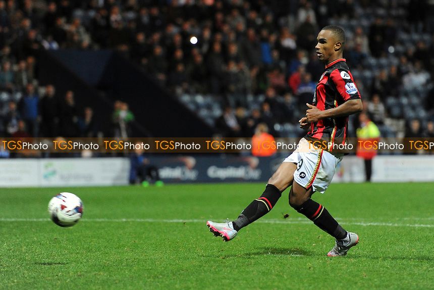 Junior Stanislas of Bournemouth scores his penalty in the shootout during Preston North End vs AFC Bournemouth at Deepdale