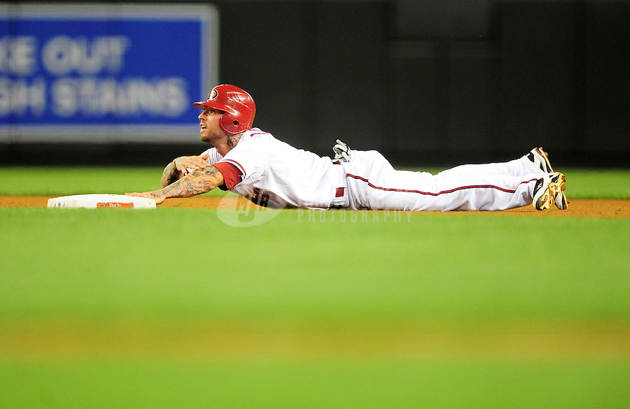 May 3, 2011; Phoenix, AZ, USA; Arizona Diamondbacks base runner Ryan Roberts reacts after being caught stealing in the seventh inning against the Colorado Rockies at Chase Field. The Diamondbacks defeated the Rockies 4-3. Mandatory Credit: Mark J. Rebilas-