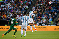 Seattle, WA - Tuesday June 14, 2016: Argentina defender Jonathan Maidana (2) goes up for a header during a Copa America Centenario Group D match between Argentina (ARG) and Bolivia (BOL) at CenturyLink Field