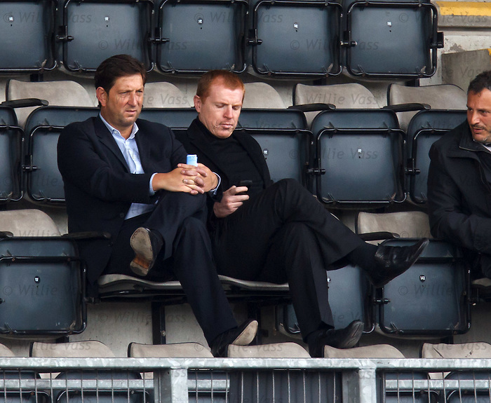 Neil Lennon checkoing his text messages