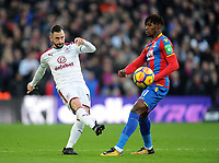 Burnley's Steven Defour vies for possession with Crystal Palace's Wilfried Zaha<br /> <br /> Photographer Ashley Crowden/CameraSport<br /> <br /> The Premier League - Crystal Palace v Burnley - Saturday 13th January 2018 - Selhurst Park - London<br /> <br /> World Copyright &copy; 2018 CameraSport. All rights reserved. 43 Linden Ave. Countesthorpe. Leicester. England. LE8 5PG - Tel: +44 (0) 116 277 4147 - admin@camerasport.com - www.camerasport.com