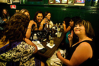 Girls night at Hussong&acute;s bar. <br /> <br /> At the oldest cantina of all Mexico and the Californias (California in USA and Baja California Mexico) opened in the year of 1892 and where the famous mexican drink known as Margarita was created, Hussong&acute;s cantina.