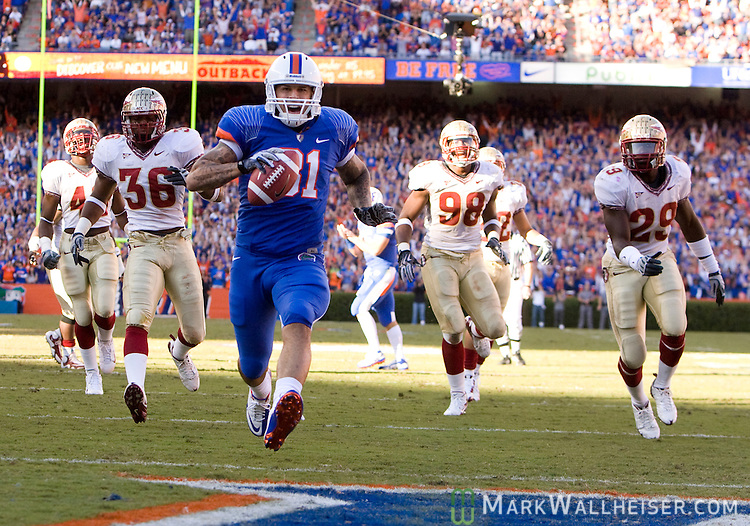 Florida Gator tight end Aaron Hernandez scores the first touchdown against the Florida State Seminoles in the first half of their NCAA football game in Gainesville, Florida November 28, 2009.  The Florida Gators defeated the Florida State Seminoles 37-10 for the 5th year in a row.