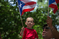 NEW YORK, NY - JUNE 11: A little boy holds a flag  during  the NYC's 60th annual Puerto Rico Day parade led by mayor Bill de Blasio on June 11, 2017 in New York City. (Photo by Maite H. Mateo/VIEWpress/Corbis via Getty Images)