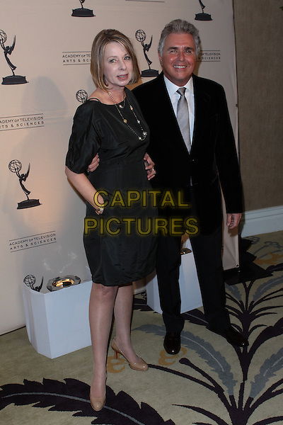 DIANE ENGLISH & STEVE TYRELL.Academy Of Television  Arts & Sciences 19th Annual Hall Fame Gala  held at The Guys & Dolls Lounge, West Hollywood, CA, USA..January 20th, 2010.full length black dress suit hand in pocket .CAP/ADM/TC.©T. Conrad/AdMedia/Capital Pictures.