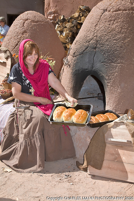 Volunteer Nancy Hart demonstrates the making of bread in a traditional outdoor adobe called a horno during the Fall Festival at Rancho de Las Golondrinas, near Santa Fe, New Mexico