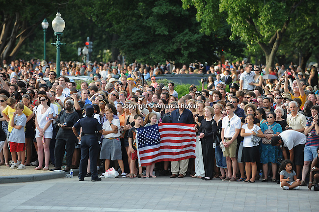 "Crowds gather to pay their final respects to Sen. Edward ""Teddy"" Kennedy outside the U.S. Senate in Washington, D.C. on August 29, 2009.  His family and the hearse carrying his body stopped briefly in front of the U.S. Capitol for prayer and remembrance en route to Arlington National Cemetery in Arlington, Virginia."
