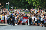 """Crowds gather to pay their final respects to Sen. Edward """"Teddy"""" Kennedy outside the U.S. Senate in Washington, D.C. on August 29, 2009.  His family and the hearse carrying his body stopped briefly in front of the U.S. Capitol for prayer and remembrance en route to Arlington National Cemetery in Arlington, Virginia."""