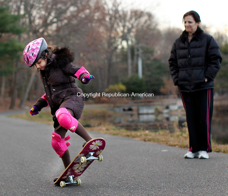 Naugatuck, CT- 14, November 2010-111410CM07  Julia Mariano, 8, of Naugatuck shows off her skateboarding skills as her mom, Tracy looks on Sunday afternoon at Baummer Pond in Naugatuck.  It was Julia's second time out on a skateboard. According to the national weather service, today is supposed to be mostly cloudy, with areas of drizzle in the morning. The high's are expected to be in the lower 50's.   Christopher Massa Republican-American