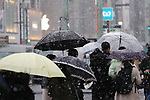 Snow falls at Ginza area in Tokyo, Japan on January 22, 2018. Japanese media predicted that heavy snow will hit Tokyo on the afternoon and night of January 22nd and expect it to settle affecting transport as workers head home in the evening and try to get to work on the 23rd. (Photo by Naoki Nishimura/AFLO)
