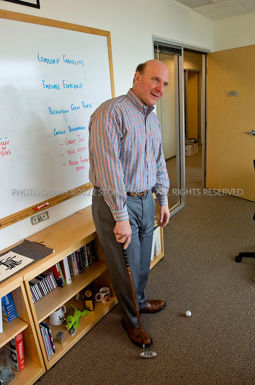1/23/2006--Redmond, WA, USA..12:05pm: Steve Ballmer, CEO of Microsoft, putts golf balls during a meeting with Lisa Brummel, Senior Vice President of Human Resources, in her office just down the hall from Ballmer's office. The meeting was to discuss Microsoft personnel matters. Ballmer often plays with his putter while in Brummel's office...Photograph ©2007 Stuart Isett.All rights reserved