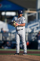 Tri-City Dust Devils relief pitcher Efrain Contreras (25) gets ready to deliver a pitch during a Northwest League game against the Everett AquaSox at Everett Memorial Stadium on September 3, 2018 in Everett, Washington. The Everett AquaSox defeated the Tri-City Dust Devils by a score of 8-3. (Zachary Lucy/Four Seam Images)