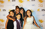 Deborah Koenigsberger - Founder & CEO of Hearts of Gold with Estephanie and family (mother of the year) at annual All That Glitters Gala - 24 years of support to New York City's homeless mothers and their cildren - (VIP Reception - Silent Auction) was held on November 7, 2018 at Noir et Blanc and the 40/40 Club in New York City, New York.  (Photo by Sue Coflin/Max Photo)