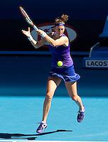 PETRA KVITOVA (CZE) against CARLA SUAREZ NAVARRO (ESP) in the second round of the Women's Singles. Petra Kvitova beat Carla Suarez Navarro 6-2 2-6 6-4..19/01/2012, 19th January 2012, 19.01.2012..The Australian Open, Melbourne Park, Melbourne,Victoria, Australia.@AMN IMAGES, Frey, Advantage Media Network, 30, Cleveland Street, London, W1T 4JD .Tel - +44 208 947 0100..email - mfrey@advantagemedianet.com..www.amnimages.photoshelter.com.