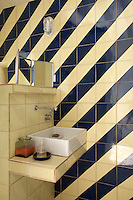 In this bathroom the tiles have been laid in a strikingly simple but effective diagonal stripe