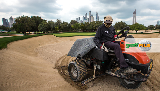 Groundskeeping staff scratching at the surface of the bunkers ahead of the 2016 Omega Dubai Desert Classic played at the Emirates Golf Club, Dubai, United Arab Emirates.  30/01/2016. Picture: Golffile | David Lloyd<br /> <br /> All photos usage must carry mandatory copyright credit (&copy; Golffile | David Lloyd)