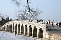 The Seventeen-Arch bridge at the Summer Palace. The Summer Palace, a palace 15km from Beijing, is mainly dominated by Longevity Hill (60 meters high) and Kunming Lake. It covers an expanse of 2.9 square kilometers, three quarters of which is water..Beijing. .Dec 2005