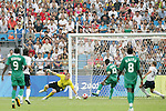 13 August 2008: Promise Isaac (NGA) (10) plays the ball past goalkeeper Brad Guzan (USA) (18) for Nigeria's first goal.  The men's Olympic team of Nigeria defeated the men's Olympic soccer team of the United States 2-1 at Beijing Workers' Stadium in Beijing, China in a Group B round-robin match in the Men's Olympic Football competition.