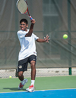 STAFF PHOTO ANTHONY REYES &bull; @NWATONYR<br /> Sriker Chikkala, of Bentonville, volleys in his match against Sameer Kamath of Fayetteville, during the 7A-West Conference boys tennis tournament Wednesday, Oct. 8, 2014 at the Springdale Har-Ber tennis courts.