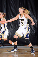 11 November 2011:  FIU's Zsofia Labady (3) defends in the second half as the FIU Golden Panthers defeated the Jacksonville University Dolphins, 63-37, at the U.S. Century Bank Arena in Miami, Florida.