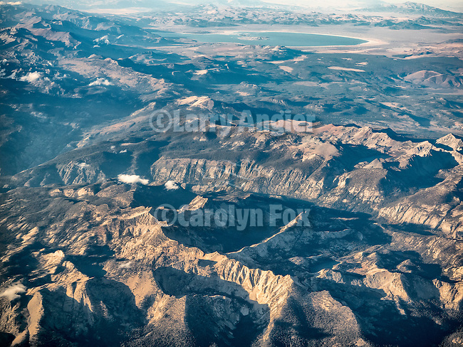 Central Sierra Nevada Range north of Mammoth Mountain  from a window seat above.<br /> <br /> Mono Lake at the top.