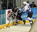 SIOUX FALLS, SD - APRIL 16:  Ian Mansfield #8 from the Sioux Falls Stampede is pushed into the boards by Justin Woods #25 from the Lincoln Stars in the first period of their 2013 USHL playoff game Tuesday night at the Sioux Falls Arena. (Photo by Dave Eggen/Inertia)