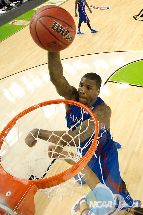 2 APR 2012: Forward Thomas Robinson (0) from the University of Kansas dunks the ball during the Championship Game of the 2012 NCAA Men's Division I Basketball Championship Final Four held at the Mercedes-Benz Superdome hosted by Tulane University in New Orleans, LA. Kentucky defeated Kansas 67-59 to claim the championship title. Chris Steppig/ NCAA Photos.