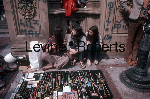 Hippies sell trinkets near Bethesda Fountain in Central Park, June 1967. (© Richard B. Levine)