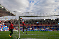 Wales goalkeepers Owain Fon Williams (standing) and Wayne Hennessey warm up ahead of the FIFA World Cup Qualifier match between Wales and Georgia at the Cardiff City Stadium, Cardiff, Wales on 9 October 2016. Photo by Mark  Hawkins / PRiME Media Images.