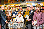 Kathleen Ward from Ballyheigue signing her book A Violation Against Women What Happened to Me at Our Lady of Lourdes at O'Mahony's Book Shop on Saturday. Pictured L-r  Peter Ward, Francis Smith, Eddie Lee, Fr Tom Leen, PJ Horgan, Mayor Kerry Pat McCarthy and Kevin Lowney.