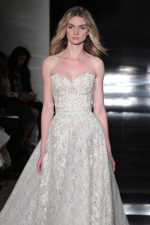 Model walks runway in an embroidered strapless Chantilly lace ball gown, from the Reem Acra Spring 2017 bridal collection, during New York Bridal Fashion Week Spring Summer 2017, on April 15, 2016.
