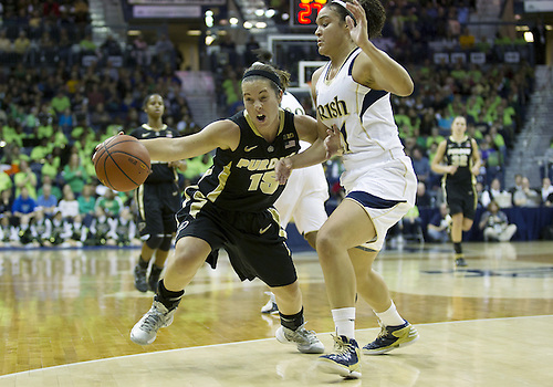 December 29, 2012:  Purdue guard Courtney Moses (15) dribbles the ball as Notre Dame guard Kayla McBride (21) defends during NCAA Women's Basketball game action between the Notre Dame Fighting Irish and the Purdue Boilermakers at Purcell Pavilion at the Joyce Center in South Bend, Indiana.  Notre Dame defeated Purdue 74-47.