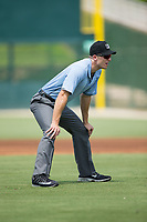 Umpire John Benken handles the calls on the bases during the South Atlantic League game between the Hagerstown Suns and the Kannapolis Intimidators at Kannapolis Intimidators Stadium on July 9, 2017 in Kannapolis, North Carolina.  The Intimidators defeated the Suns 3-2 in game one of a double-header.  (Brian Westerholt/Four Seam Images)