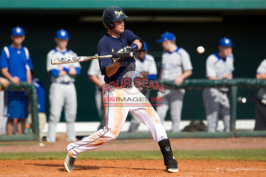 Michigan Wolverines shortstop Derek Dennis #19 at bat during a game against the Seton Hall Pirates at the Big Ten/Big East Challenge at Al Lang Stadium on February 18, 2012 in St. Petersburg, Florida.  (Mike Janes/Four Seam Images)